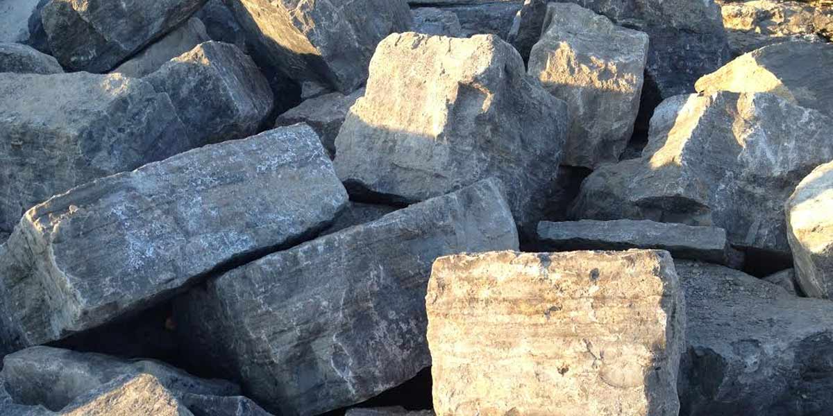 Premium Charcoal armour stone piled in yard
