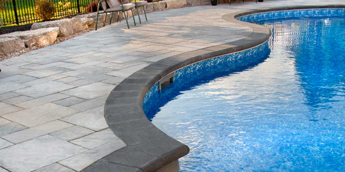 Barollo Cap coping and caps around rounded pool