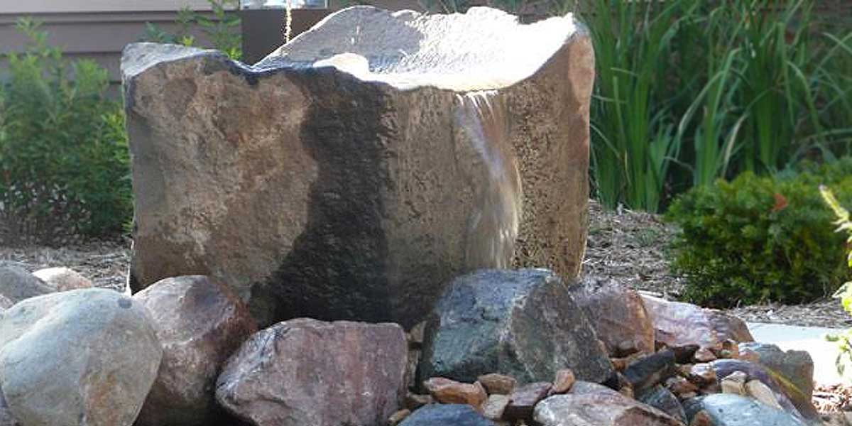 Basalt Natural Bowls Drilled water stone in rock pile