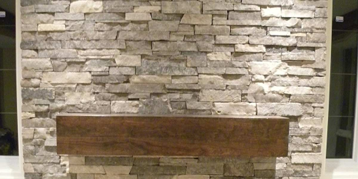 Oxford Ledge veneer stone fireplace wall
