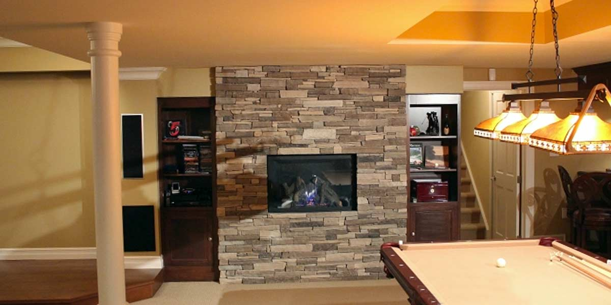 Oxford Ledge veneer stone rec room wall with fireplace insert