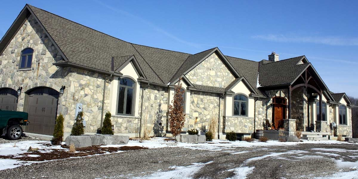 Rubble Buff veneer stone mansion home