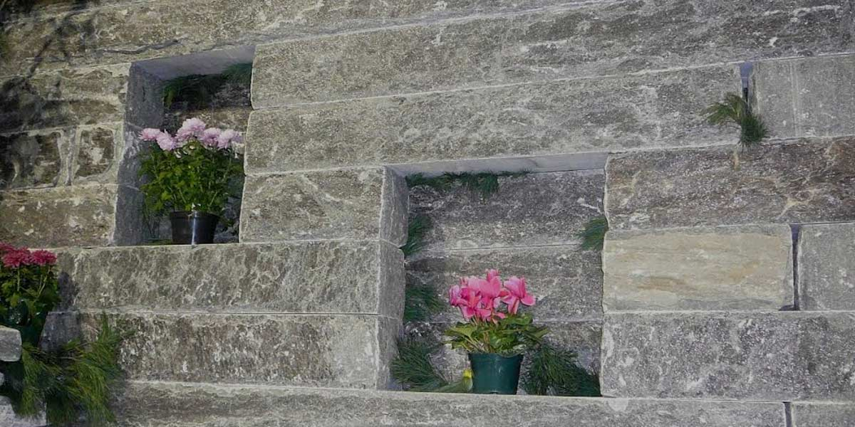 "Sawn Armour 12"" x 12"" armour stone wall with inset planters"
