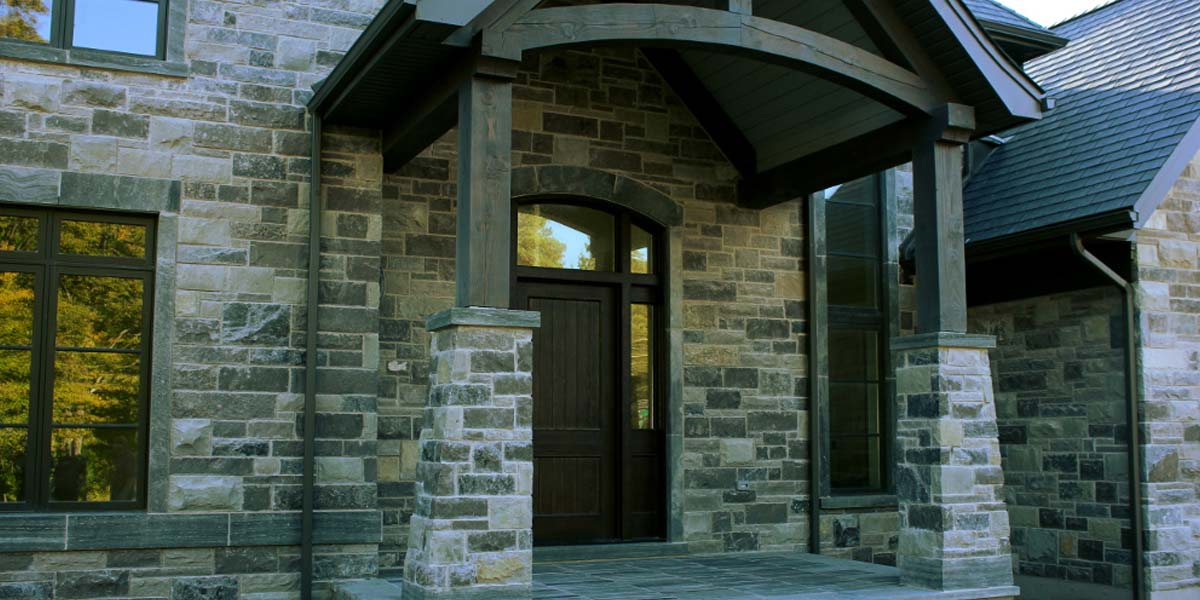 Vermont Grey veneer stone arched timber entrance